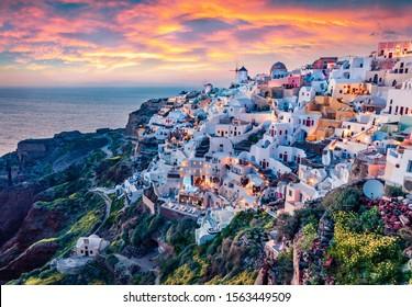 Astonishing evening view of Santorini island. Magnificent summer sunset on famous Greek resort Oia, Greece, Europe. Fantastic seascape of Mediterranena sea. Traveling concept background.