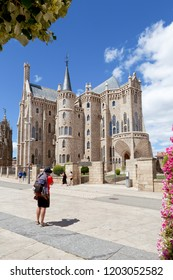 Astorga (Spain) - View of the gothic cathedral of Astorga, and a pilgrim along the Saint James way