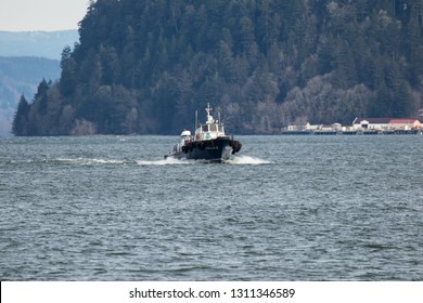 Astoria, Oregon - 2/7/2019:  An off shore support vessel heading for the West end mooring basin, Astoria, Oregon