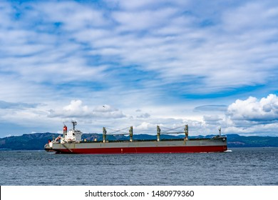Astoria, Oregon - 8/11/2019: An ocean going freighter in the columbia River, traveling up river, oposite Astoria, Oregon