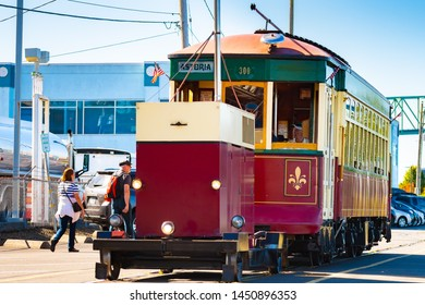 Astoria, Oregon - October 03 2017: The Astoria Riverfront Trolley in motion, a heritage tram/ streetcar line which uses former freight railroad tracks along the south bank of the Columbia River.