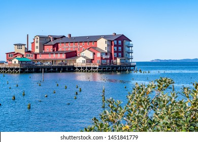 Astoria, Oregon - October 03 2017: The red Cannery Pier Hotel and Spa building, a luxury boutique hotel on Columbia River on the sea coast of Astoria near to the Astoria Megler Bridge.