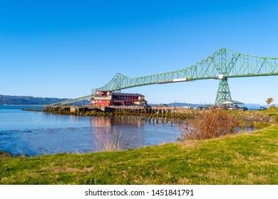 Astoria, Oregon - October 03 2017: The Cannery Pier Hotel and Spa, a luxury boutique hotel on Columbia River on the coast of Astoria next to the iconic Astoria Megler Bridge.