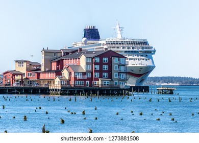 Astoria, Oregon - October 3 2017: NCL Sun cruise ship docked in downtown Astoria behind the Cannery Pier Hotel and Spa on the Columbia River