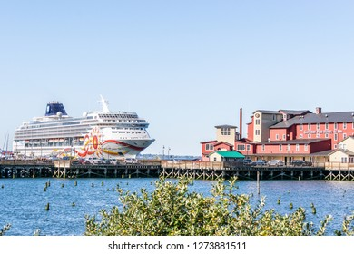 Astoria, Oregon - October 3, 2017: NCL Sun cruise ship docked in downtown Astoria behind the Cannery Pier Hotel and Spa on the Columbia River