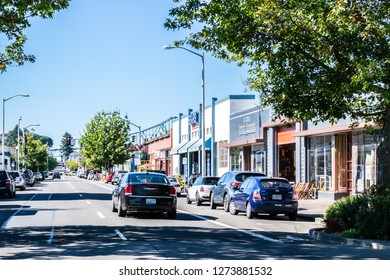 Astoria, Oregon - October 3, 2017: Street view in downtown Astoria with Astoria-Megler Bridge in the background