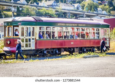 Astoria, Oregon - October 3, 2017: Astoria Riverfront Trolley taking tourists on a tour around downtown Astoria using old freight railroad tracks near the Columbia River