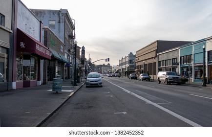 Astoria, Oregon / USA - March 24 2019: Looking west on Commercial Street in Astoria Oregon. Liberty Theater, 13th Street Alley, Paramount Drug, Garbo's Vintage Wear, Wells Fargo, Carruthers