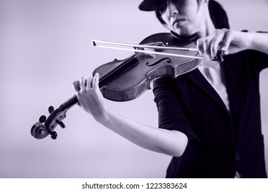 The astract art desibn background of violin was playing by the lady,blurry light design background