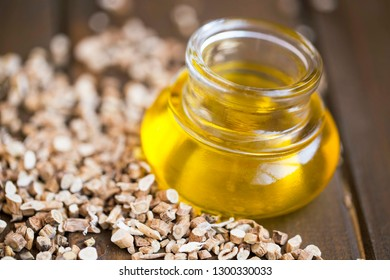 Astragalus oil, chinese medicinal herbal root, herbal medicine, alternative fitoterapy medicine