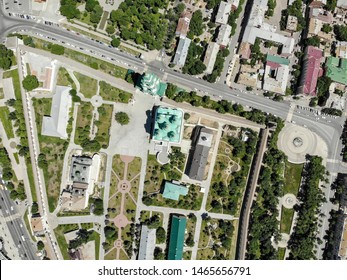 Astrakhan. Astrakhan Kremlin and Lenin Square top view. Fortress. Assumption Cathedral and the bell tower of the Astrakhan Kremlin. Flying drone over the Kremlin. Panorama of the city of Astrakhan.