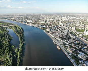 Astrakhan. Panorama of the city of Astrakhan. The central embankment of the city, Swan Lake. The bridge over the highway bridge across the Volga. Monument to Peter 1 on the park for rest and walks.