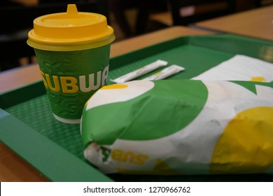 Astrakhan, Russia  08 Oct. 2018: Subway sandwich and takeaway cup on tray with Subway-logo on it. Subway is second in popularity fast food chain in Russian market after McDonald's