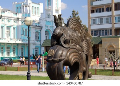 """ASTRAKHAN, RUSSIA - 4 SEPTEMBER 2012. The sculptural composition """"the Golden fish"""" on the Central promenade, on September 4, 2012 in Astrakhan, Russia"""