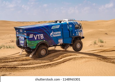 Astrakhan, Russia - July 24, 2018: Sports truck KAMAZ gets over the difficult part of the route during the Silk Way rally Astrakhan-Moscow