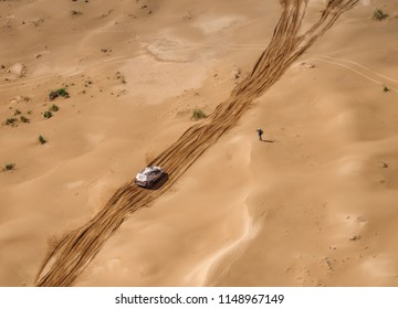 Astrakhan, Russia - July 24, 2018: Sports car Toyota gets over the difficult part of the route during the Silk Way rally Astrakhan-Moscow (aerial view)