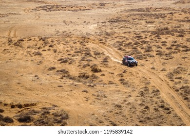 Astrakhan, Russia - July 24, 2018: Sports car MINI gets over the difficult part of the route during the Silk Way rally Astrakhan-Moscow (aerial view)