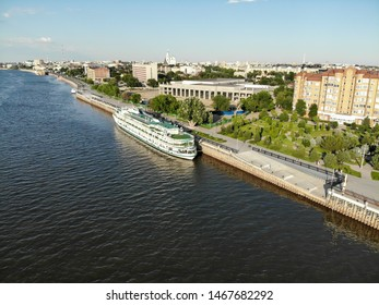 Astrakhan / Russia - June 13, 2019: Passenger ship stands at the pier of the central embankment of the city of Astrakhan.