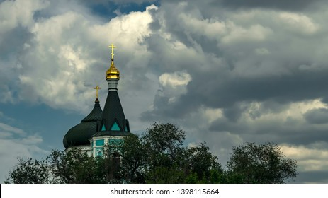 Astrakhan, Russia - May 13, 2019: Church of the Intercession of the Blessed Virgin of the Russian Orthodox Old Believers. The Church on the background of mighty heap clouds and blue sky.