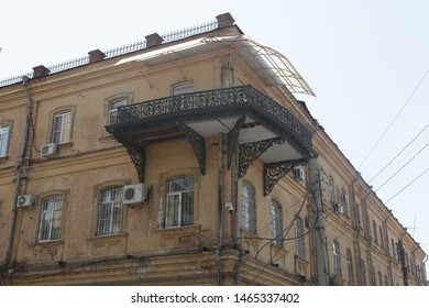 ASTRAKHAN, RUSSIAN FEDERATION - AUGUST 10, 2017: House with balcony on Uritsky Street, 7 in Astrakhan city, Russia. Old beautiful architecture