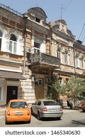 ASTRAKHAN, RUSSIAN FEDERATION - AUGUST 10, 2017: House with balcony on Uritsky Street, 8 in Astrakhan city, Russia. Old beautiful architecture