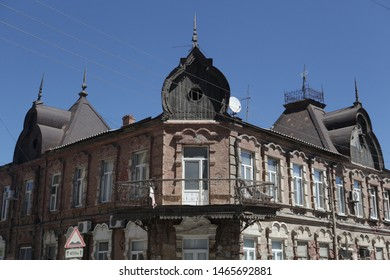 ASTRAKHAN, RUSSIAN FEDERATION - AUGUST 10, 2017: House (city estate) with wooden roof on Darwin Street, 35 in Astrakhan city, Russia. Old beautiful architecture