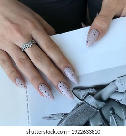 ASTRAKHAN;RUSSIA 15 OCTOBER 2020: Women's gray manicure with design.Hands of a woman with gray manicure on nails. Manicure beauty salon concept. Empty place for text or logo.