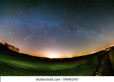 Astro landscape with the Milky Way as seen from Trostberg in Bavaria in Germany.