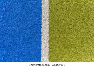 Astro Turf Sports Lines Sports astro synthetic turf field closeup boundary white line with green and blue detail.