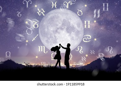 Astrological zodiac signs inside of horoscope circle. Couple singing and dancing over the zodiac wheel and milky way background. The power of the universe concept.