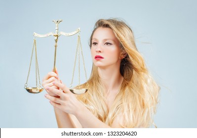 Astrology and horoscope concept, beautiful woman with scales. Femida. Libra Zodiac Sign