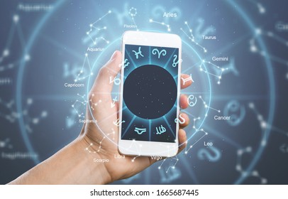 Astrology illustration concept and human hand holding smartphone