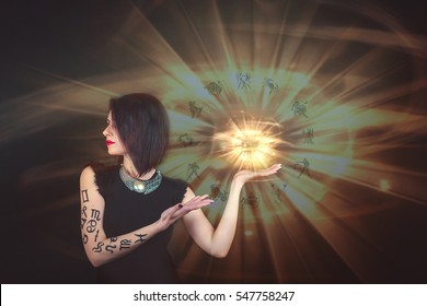 Astrology. Signs of the zodiac horoscope. A girl holding a crystal ball with a halo of zadiaka signs