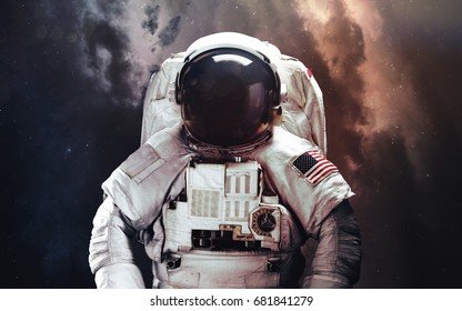 Astronaut. Abstract space wallpaper. Universe filled with stars, nebulas, galaxies and planets. Elements of this image furnished by NASA