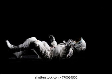 Astronaut with black background.