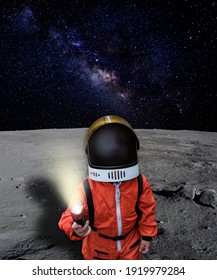 An astronaut child looking up to the sky on the surface of the moon with outer space on the background. Elements of this image furnished by NASA.