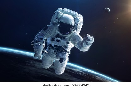 Astronaut in deep space. Elements of this image furnished by NASA