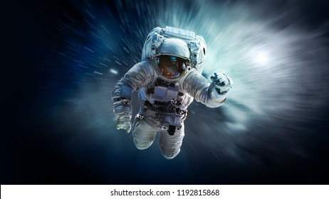 Astronaut in deep space floating in weightlessness. Galaxy on the background. Space art wallpaper. Elements of this image furnished by NASA