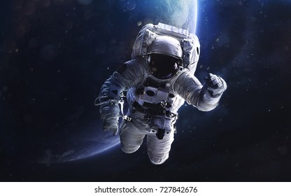 Astronaut. Deep space image, science fiction fantasy in high resolution ideal for wallpaper and print. Elements of this image furnished by NASA