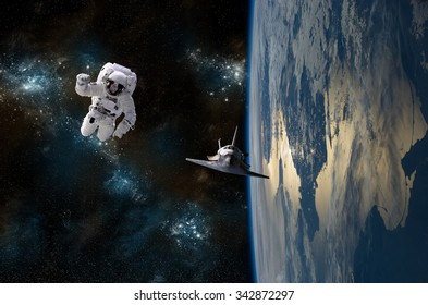 An astronaut drifting in space is rescued by a space shuttle orbiting Earth. -  Elements of this image furnished by NASA