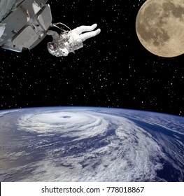 Astronaut, earth and moon. The elements of this image furnished by NASA.
