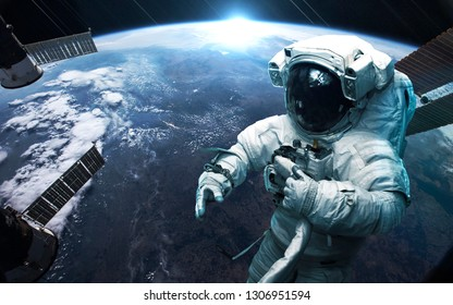 Astronaut at the Earth planet orbit. Awesome science fiction render. Elements of this image furnished by NASA