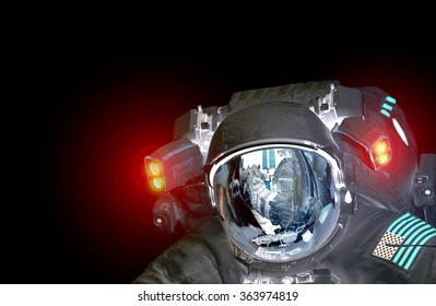 Astronaut et alien extraterrestrial helmet isolated on black spaceman space suit. Elements of this image furnished by NASA.