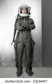 astronaut fashion woman full length space suit helmet silver studio background
