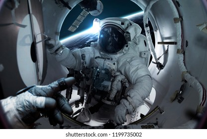 Astronaut at the international space station orbiting Earth planet. Elements of this image furnished by NASA