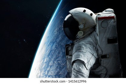 Astronaut looks at space. Spacewalk. Elements of this image furnished by NASA