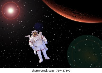 Astronaut and mars on the backdrop. The elements of this image furnished by NASA.