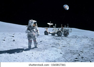 Astronaut near the moon rover on the moon. With land on the horizon. Elements of this image were furnished by NASA.