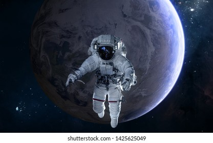 Astronaut on background of Earth. Solar system. Science fiction. Elements of this image furnished by NASA