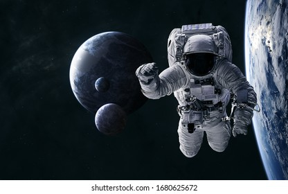 Astronaut on the background of planets in deep space. Science fiction. Elements of this image furnished by NASA